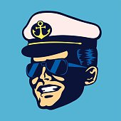 Retro cruise ship captain head with hat and sunglasses vector
