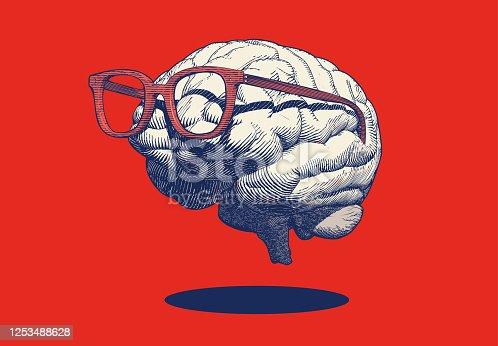 istock Retro drawing of brain with eyeglasses illustration on red BG 1253488628