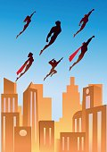 A retro styled vector illustration of a team of superheroes flying above city. AICS5 file included.