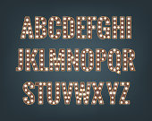 Retro font with light bulbs. Shiny letters