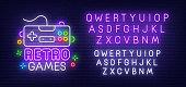 Retro Games neon sign, bright signboard, light banner. Gamer logo. Neon sign creator. Neon text edit.