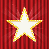 Retro gold star. Vintage frame with lights isolated on red curtain