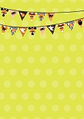 Halloween bunting with polka dots on green. With Halloween icons - ghosts, corn candy, cat, spider, bat & owl. Design at top, leaving space for copy. Ideal for invite.