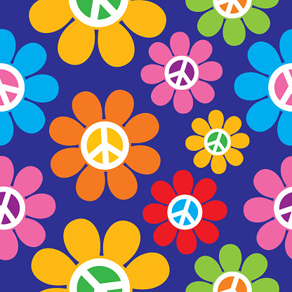 Vectro seamless pattern of colorful retro peace sign flowers on a blue background.