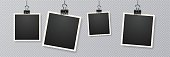 istock Retro realistic frame placed on transparent background. Picture frames with shadow hanging with paper clip 1132428167