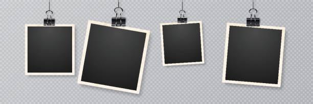 illustrazioni stock, clip art, cartoni animati e icone di tendenza di retro realistic frame placed on transparent background. picture frames with shadow hanging with paper clip - foto
