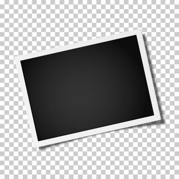 illustrazioni stock, clip art, cartoni animati e icone di tendenza di retro realistic vector photo frame placed horizontally slightly tilted on transparen background. template photo design. - foto