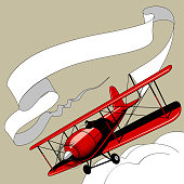 Retro red airplane with the ribbon banner in the sky. Vintage engraving and pop art stylized drawing. Vector illustration