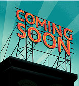 istock Retro rooftop billboard sign that reads Coming Soon 1272696772