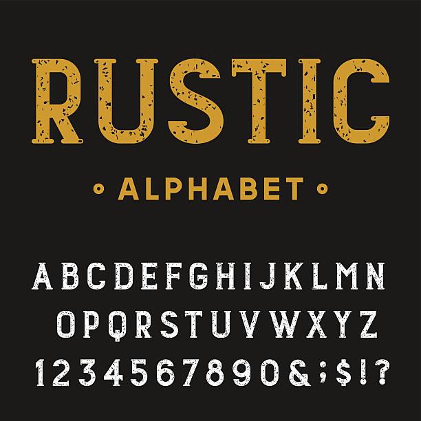 retro rustic alphabet vector font. - rustik stock illustrations