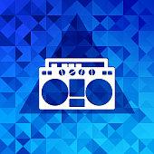 Retro tape recorder.Triangle background.