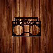 Retro tape recorder.Wooden background