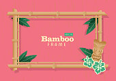 Retro wooden Summer Tiki Bamboo frame on pink background poster advertisement design template. Cute a  cute Tiki style frame which includes sample text design, hawaiian, tiki, asian themes. Turquoise or on a summery background.  Easy to edit printable with layers. Vector illustration royalty free. Lot's of texture and vintage Hawaiian style.