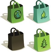 Four reusable fabric grocery shopping bags.