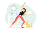 A woman in the black t-shirt and red pants practices yoga at home with a cat in a reverse warrior pose. Flat style character vector illustration on a green background.