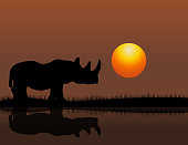 Vector of Rhino at Sunset Background. EPS Ai 10 file format.