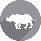 Vector illustration of a grey rhino icon in flat style.
