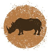 Rhino silohutte and round background. Editable vector file.
