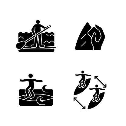 Riding waves in ocean black glyph icons set on white space