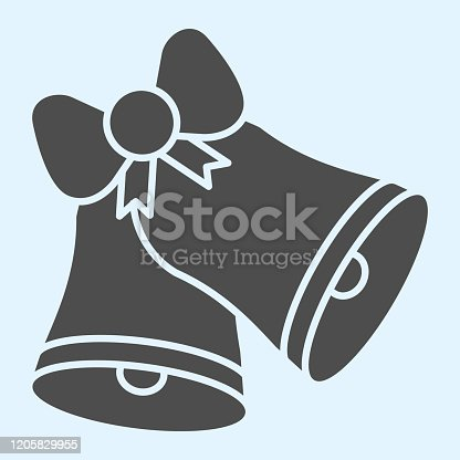 istock Ringing bells solid icon. Two classic bell with ribbon bow. Wedding asset vector design concept, glyph style pictogram on white background, use for web and app. Eps 10. 1205829955