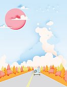 Road trip with car and natural autumn pastel color scheme backgroud paper cut style vector illustration