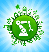 Robotic Hand Environment Green Button Background on Blue Sky. The main icon is placed on a round green shiny button in the center of the illustration. Environmental green living lifestyle icons go around the circumference of the button. Green building, man on a bicycle, trees, wind turbine, alternative energy and other environmental conservation symbols complete this illustration. The background has a blue glow effect.