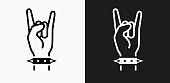 Rock Icon on Black and White Vector Backgrounds. This vector illustration includes two variations of the icon one in black on a light background on the left and another version in white on a dark background positioned on the right. The vector icon is simple yet elegant and can be used in a variety of ways including website or mobile application icon. This royalty free image is 100% vector based and all design elements can be scaled to any size.