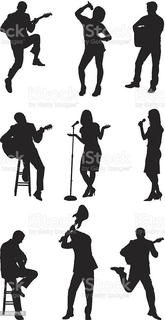 Rock stars singing and playing guitar vector art illustration