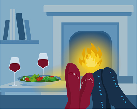 Romantic dinner at home close to fireplace.