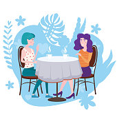 Romantic meeting of two girlfriends in a cafe. Sit drinking coffee in chairs, have fun and relaxation
