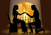 A young man makes a proposal to the girl, kneeling beside the fireplace.