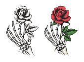 Rose flower in human skeleton hand