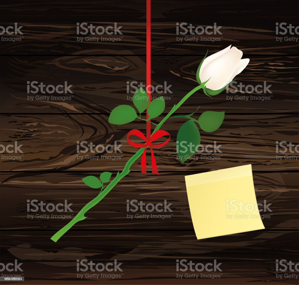 A rose flower is hanging on a red ribbon with a bow yellow sheet of a rose flower is hanging on a red ribbon with a bow yellow sheet of stopboris Images