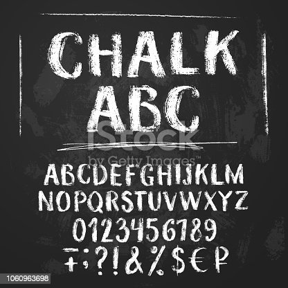 Rough chalk latin alphabet on textured chalkboard background. Uppercase letters, numbers, sumbols, money signs.