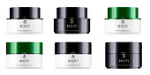 Round black and white set, plastic jars with black and green glossy lid for cosmetics - body cream, gel, butter, bath salt, skin care, powder. Realistic packaging mockup template. Vector illustration.