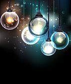 Round glass transparent light bulb on a luminous background.