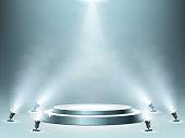 istock Round podium with smoke effect and spotlights 1200893616