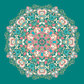 Kaleidoscopic fantasy floral pattern in green and pink tones,mandala.Ornamental round background.Vector illustration.