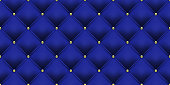 Royal blue background with gold buttons pattern. Vector leather or velvet vintage luxury upholstery with golden buttons seamless pattern background