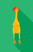 Vector illustration of a rubber chicken against a green background in flat style.