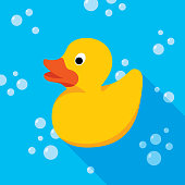 Vector illustration of a yellow rubber duck against a blue background with bubbles in flat style.
