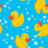 Vector illustration of rubber ducks with bubbles in a repeating pattern.