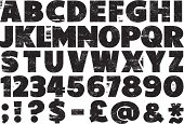 Upper case rubber stamp alphabet set with numbers, punctuation and other characters.