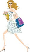 Pretty chic girl with shoppig bags and fresh flowers