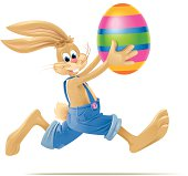 Vector illustration of a running easter bunny carrying a colorful striped easteregg holding it with two paws in front. It wears a jeans with straps and looks happily at the camera. No background