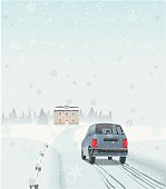 A car is approaching the holiday house on the country site were the family will celebrate their winter reunion.