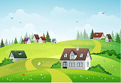 Rural summer landscape with hills and village.