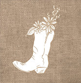 Vector illustration of a  Rustic burlap background cowboy boot with flowers. Easy to edit with layers.