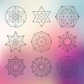Abstract vector sacred geometrical figures on blurred background