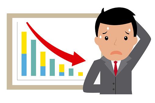 sad businessman for bad results graph